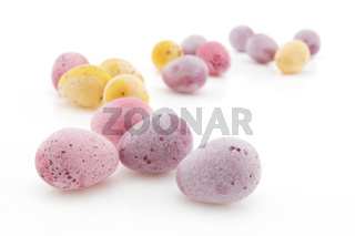 Small Easter eggs on white with selective focus and shallow depth of field