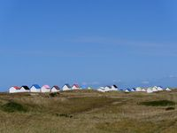 wooden huts in the dunes of Gouville sur Mer, normandy