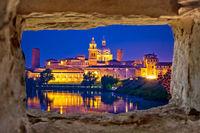 City of Mantova skyline evening view through stone window