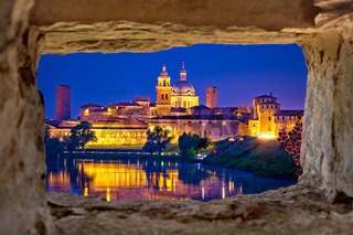 City of Mantova skyline evening view through stone window