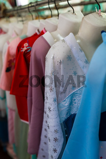 Row of ladies dresses for sale in chinese shop