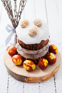 Easter cake and painted eggs on a white background