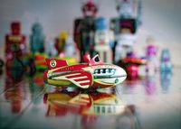 retro Rocket toy on wooden floor