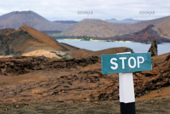 Pinnacle-rock, Bartolomé, Galapagos with stop-sign