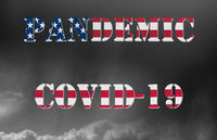 Pandemic warning of quarantine due to Covid-19 or corona virus in USA flag letters against dark clouds
