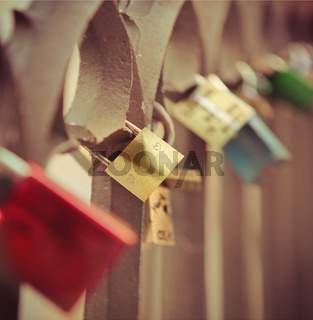 Love locks hang from a bridge in Prague