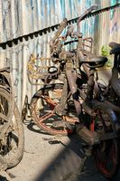 Old rusty rental bicycles taken out of the river Spree on the banks of the river in Berlin