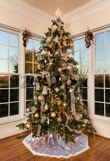 Decorated christmas tree in modern family room