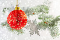 Christmas or winter background with a red ball.