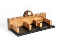 Decorative table wooden watches with pen holes and a place for papers on an isolated background.