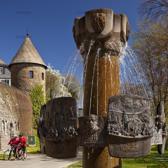 History fountain with city wall and angel tower, Olpe, North Rhine-Westphalia. Germany, Europe