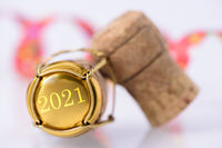 cork of champagne with new year date 2021