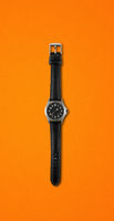 Wrist watch isolated on orange background