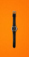 Wrist watch isolated on orange background