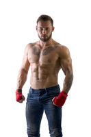 Muscular man in red gloves for MMA, mixed martial arts,