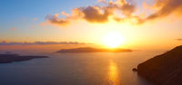 Panoramic view of sunset over the sea in Santorini