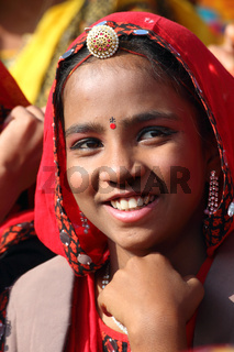 Portrait of smiling Indian girl at Pushkar camel fair