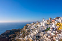 White Houses and Windmills on a Mountainside in Santorini