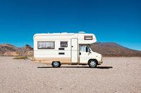vintage camping bus, rv camper van in desert landscape -