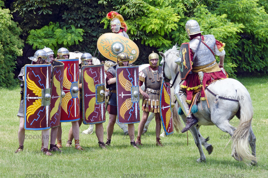 mounted roman soldier attacking legionaries