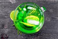 Lemonade Tarragon in goblet on board top