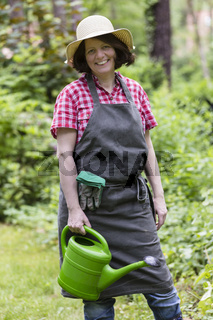 Gärtnerin mit Giesskanne, gardener with watering can