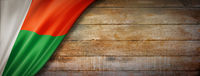 Madagascar flag on vintage wood wall banner