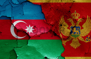 flags of Azerbaijan and Montenegro painted on cracked wall