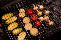 Tasty vegetables and mushrooms in grill grate