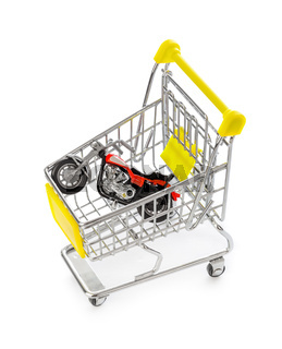 Toy motorbike in shopping cart