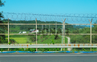 Barbed wire fenced border of the DMZ seperating North and South Korea at Dorasan Station, Republic of Korea