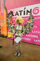 Model with popcorn hair and wings from magazines in photo zone a