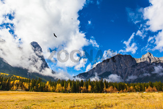 The mountain, covered in lush white clouds