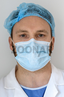 Portrait of a doctor with face mask in the hospital