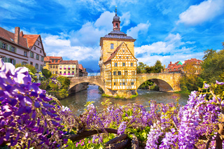 Scenic view of Old Town Hall of Bamberg (Altes Rathaus) with two bridges over the Regnitz river flower view