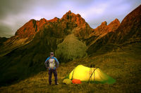 Hiker Man with Backpack and Tent enjoying Alpenglow at the mountain Grosser Wilder in Bavarian Alps, Allgau, Germany.