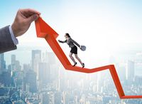 The businesswoman climbing line chart in economic recovery conce
