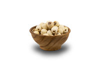 Dried Lotus Seeds in wooden bowl on white background.
