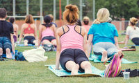 men and women on yoga training in the park