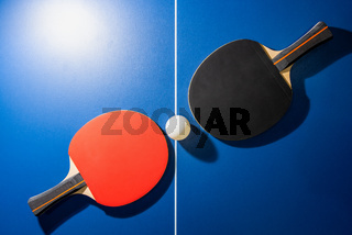 Top view black and red table tennis racket