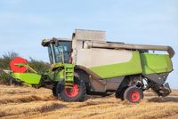 Combine harvester harvests ripe wheat. Agriculture.