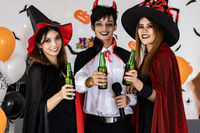 Asian group of friend celebrate and cheers halloween party.