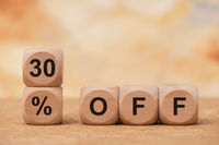 30% off printed on wooden cubes