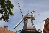 Windmill in front of a blue sky