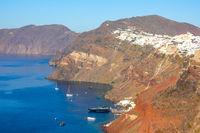 White Houses in Oia on a Sunny Day and Several Yachts Parked Near Santorini