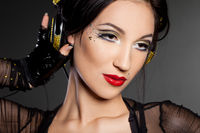 girl DJ listens music with headphones