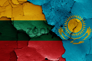 flags of Lithuania and Kazakhstan painted on cracked wall
