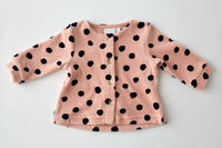 pink cardigan for baby girl on white background