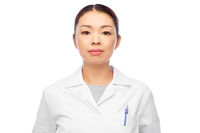 asian female doctor in white coat