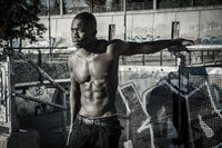 Hot buff young black man posing outdoor